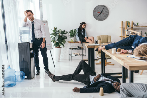 group of exhausted business partners sleeping at office stock photo