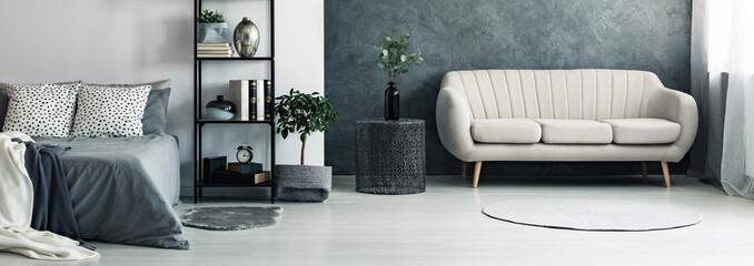 Sofa in bright grey bedroom