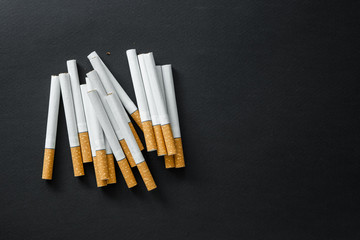 Cigarettes on a dark background.