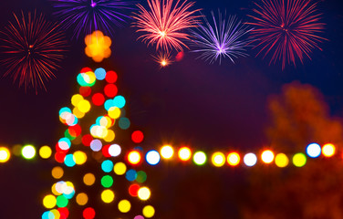 Unfocused Christmas Tree with a Fireworks by Night