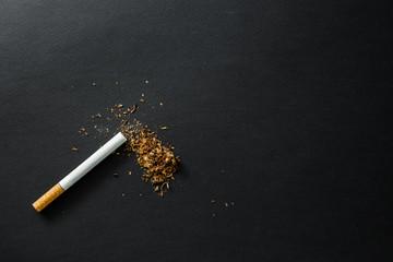 Broken cigarette on a dark background. quit Smoking