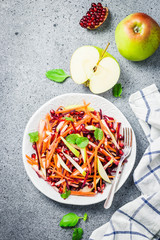 Healthy carrot beetroot apple salad on stone background. Top view, copy space.