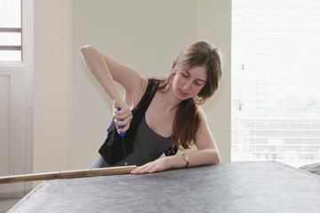 Girl using screwdriver