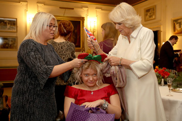 Britain's Camilla, Duchess of Cornwall is seen with a child from Helen & Douglas House and Roald Dhal's Marvellous Children's Charity at Clarence House  in London