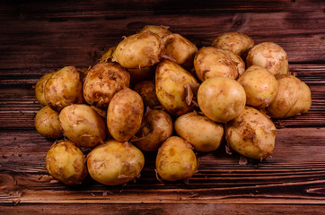 Pile of the young potato on wooden table. Top view
