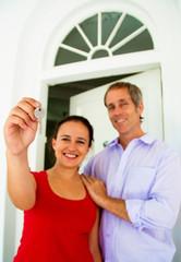 Couple hold up house key