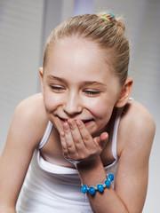 Laughing girl washing her face