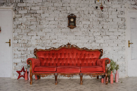 Vintage royal red sofa in a room