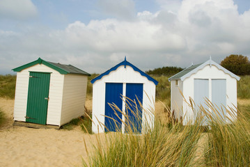 Brightly colored huts on beach
