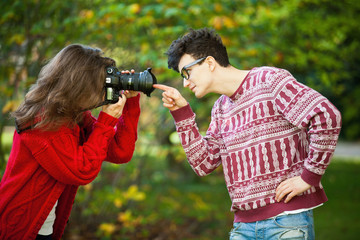 Teenage girl taking picture of boyfriend