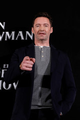 "Australian actor Hugh Jackman poses for photographers ahead of a premiere of his latest film, a musical directed by Michael Gracey called ""The Greatest Showman"", in Mexico City,"