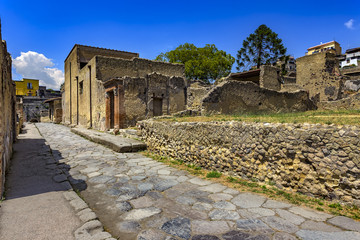 Italy. Ruins of Herculaneum (UNESCO World Heritage Site) - Decumanus Inferior (lower Decumanus street) and house with the Large Doorway