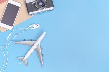 Plane and travel objects on blue copy space for poster
