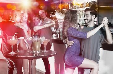 Couple dancing tango in bar