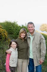 Family standing in garden