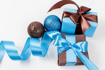 gift box with ribbon in blue and brown