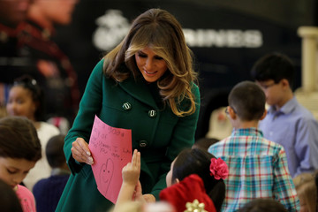 U.S. first lady Melania Trump joins children to make holiday cards for the Marine Corps Reserve Toys for Tots campaign at Joint Base Anacostia-Bolling in Washington
