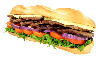 Beef steak and salad filled crusty baguette sandwich isolated on a white background