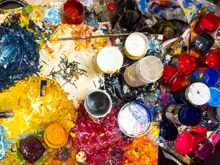 brushes, palette and paints captured from above