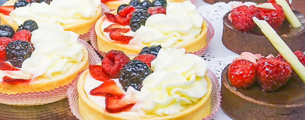Fresh Fruit Tarts and Chocolate Tortes in Bakery