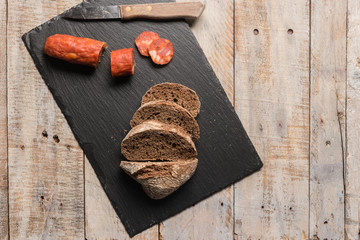 Malt loaf bread and chorizo slices