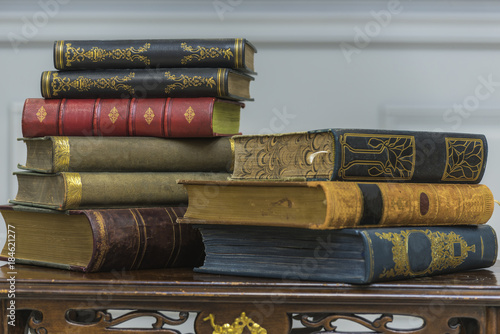A Stack Of Old Books On The Coffee Table Stock Photo And Royalty