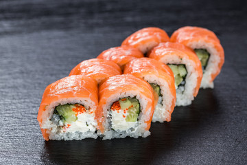 Salmon philadelphia makizushi roll arranged on stone background