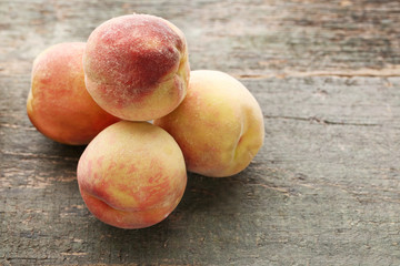 Ripe peaches fruit on grey wooden table