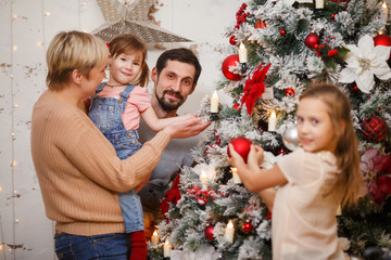 Image of happy family near decorated New Year tree