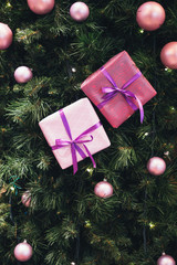 Picture of New Year's background with fir-tree balls, purple boxes