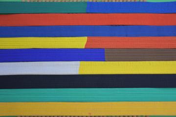 Karate belts on bamboo cane background