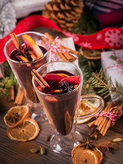 Mulled wine with fruits, cinnamon sticks, anise and decorations