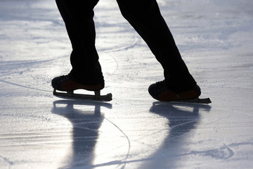 silhouette foot ice-skating person on the ice rink.