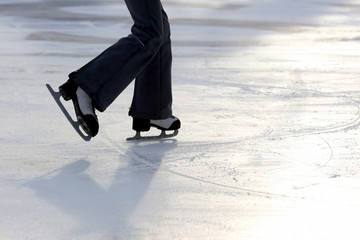 foot ice-skating person on the ice rink.