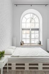 Pallet bed in loft bedroom