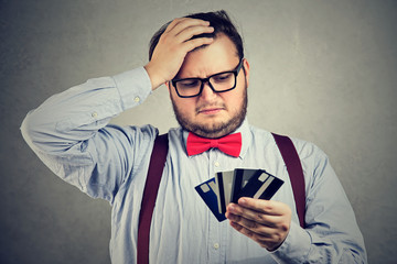 Confused man having problems with debt