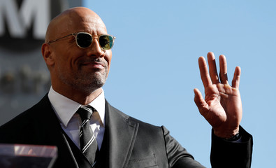 Actor Johnson waves before unveiling his star on the Hollywood Walk of Fame in Los Angeles