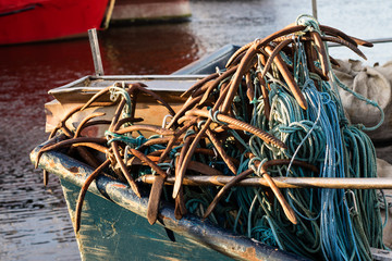Anchors and ropes on a fishing boat. Fishing boats and nets in the fishing port.