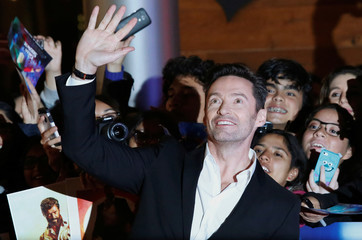 "Australian actor Hugh Jackman waves to fans during the red carpet of his latest film, a musical directed by Michael Gracey called ""The Greatest Showman"", in Mexico City"
