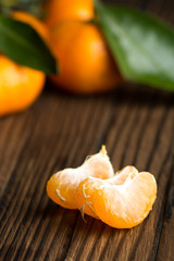 Peeled Mandarin slices on a wooden table