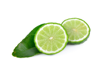 half cut fresh bergamot with leaf on white background