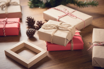 Closeup gift boxes for Christmas decorations on table wood background.