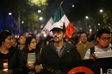 Mexican actor Diego Luna marches as he protests against a new security bill, Law of Internal Security, in Mexico City