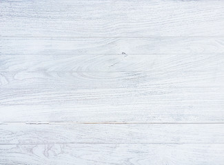 Close up the blurry old white wooden floor grain teak panel with over white light texture  background.