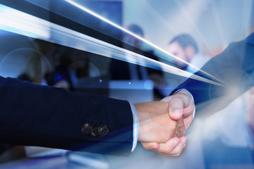 Handshake confirming business partnership