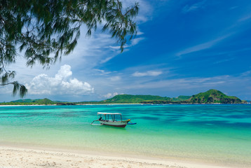 Canvas Prints Tropical beach tropical beach in island Lombok, Indonesia with boat and turquoise lagoon.