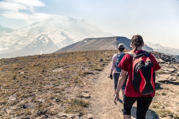 Two women hiking along an alpine trail, Mt Rainier, Washington, America, USA