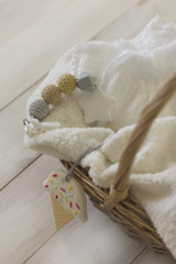 Disposable diapers on towel in wicker basket. Delicate still life, newborn concept