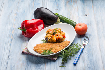 breaded fish fillet with caponata