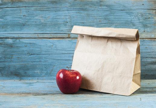 paper bag on old wooden background